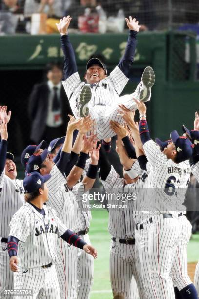 Head coach Atsunori Inaba of Japan is tossed into the air after the Eneos Asia Professional Baseball Championship 2017 final game between Japan and...