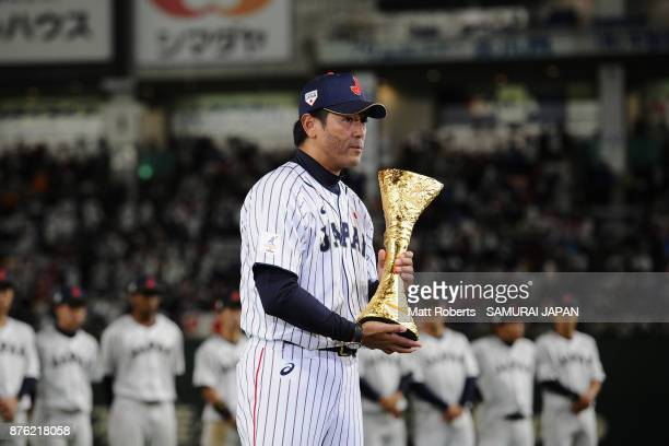 Head coach Atsunori Inaba of Japan reeives the trophy at the award ceremony after the Eneos Asia Professional Baseball Championship 2017 final game...