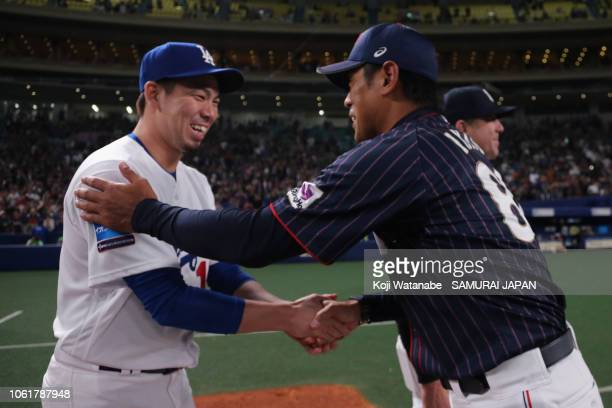 Head coach Atsunori Inaba of Japan shakes hands with Pitcher Kenta Maeda of the Los Angeles Dodgers after the game six between Japan and MLB All...