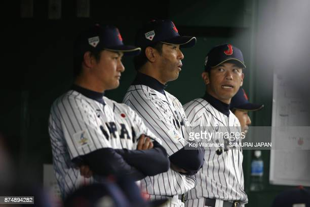 Head coach Atsunori Inaba of Japan talks with coaches during the Eneos Asia Professional Baseball Championship 2017 game between Japan and South...