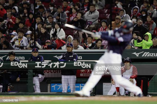 Head coach Atsunori Inaba of Japan watches Outfielder Shogo Akiyama of Japan hitting a single in the top of 3rd inning during the game four between...
