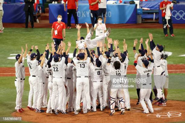 Head coach Atsunori Inaba of Team Japan is tossed into the air as they celebrate winning the gold after their 2-0 victory over Team United States in...