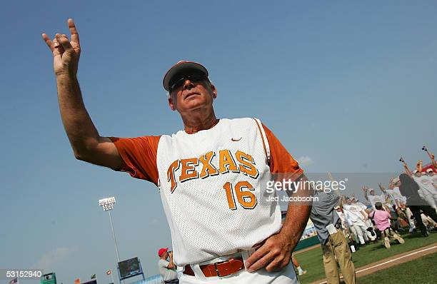Head coach Augie Garrido of the Texas Longhorns celebrate after defeating the Florida Gators during Game 2 of the championship series of the 59th...