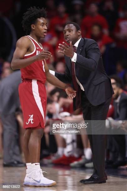 Head coach Avery Johnson of the Alabama Crimson Tide talks with Collin Sexton during the second half of the college basketball game against the...