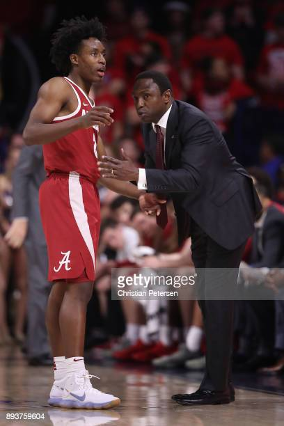 Head coach Avery Johnson of the Alabama Crimson Tide talks with Collin Sexton during the first half of the college basketball game against the...