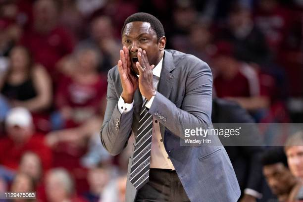 Head Coach Avery Johnson of the Alabama CrimsonTide yells at his team during a game against the Arkansas Razorbacks at Bud Walton Arena on March 9,...