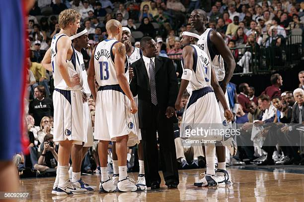 Head coach Avery Johnson of the Dallas Mavericks talks to his team during a timeout in the preseason game against the Detroit Pistons at American...