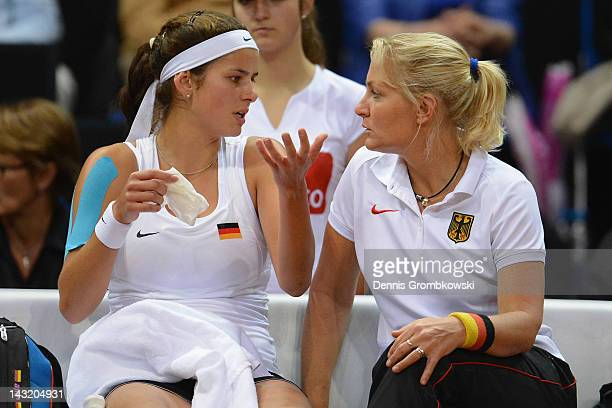 Head coach Barbara Rittner of Germany gives instructions to Julia Goerges during day one of the Federation Cup 2012 World Group Play-Off match...