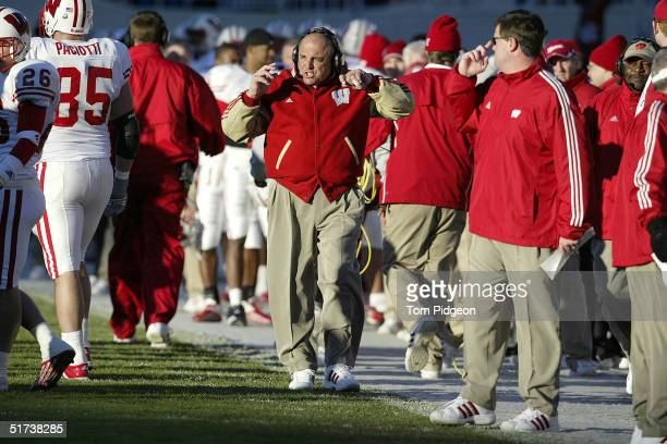 Head Coach, Barry Alvarez of Wisconsin walks the sidelines in the second quarter against Michigan State on November 13, 2004 at Spartan Stadium in...
