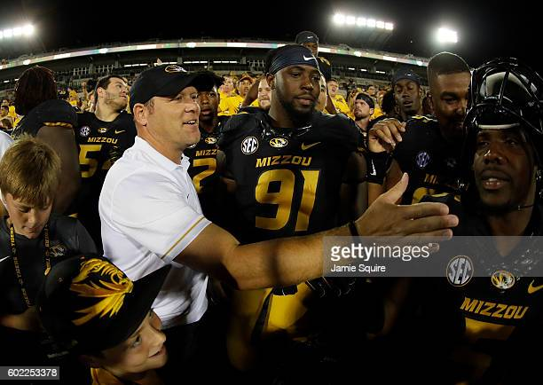 Head coach Barry Odom of the Missouri Tigers celebrates with players after the Tigers defeated the Eastern Michigan Eagles 6121 to win the game at...