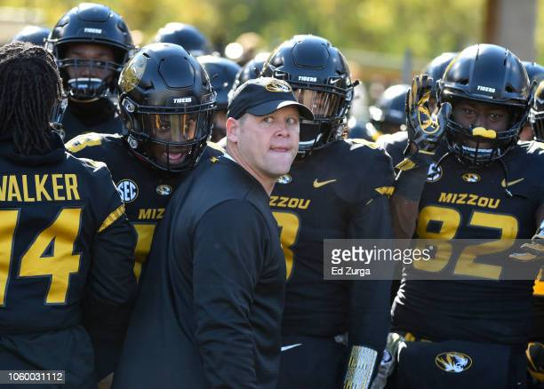 Head coach Barry Odom of the Missouri Tigers prepares to lead his team onto the field for a game against the Vanderbilt Commodores at Memorial...