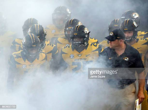 Head coach Barry Odom of the Missouri Tigers prepares to run onto the field with players prior to the game against the Auburn Tigers at Faurot...