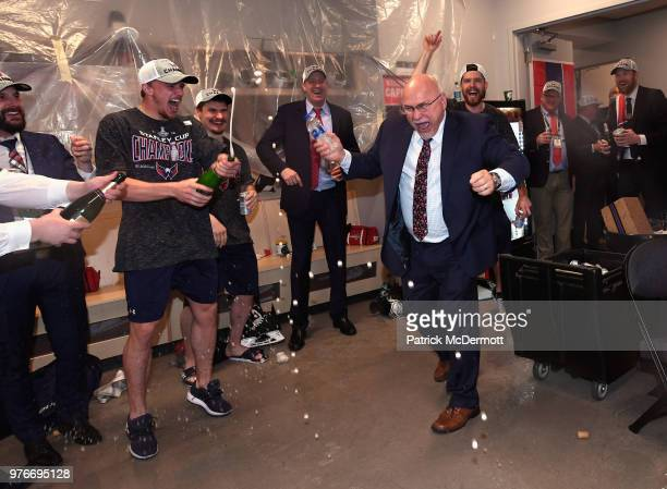 Head coach Barry Trotz of the Washington Capitals celebrates as he walks into the locker room after his team won the Stanley Cup by defeating the...