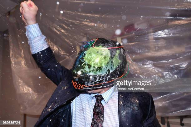 Head coach Barry Trotz of the Washington Capitals celebrates winning the Stanley Cup in the locker room after his team defeated the Vegas Golden...