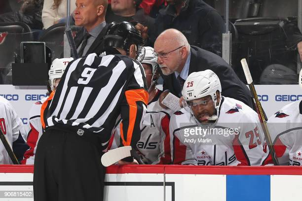 Head Coach Barry Trotz of the Washington Capitals speaks with Referee Dan O'Rourke during the game against the New Jersey Devils at Prudential Center...