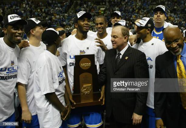 Head coach Ben Howland and the UCLA Bruins pose together with the western regional trophy after the final of the NCAA Men's Basketball Tournament...