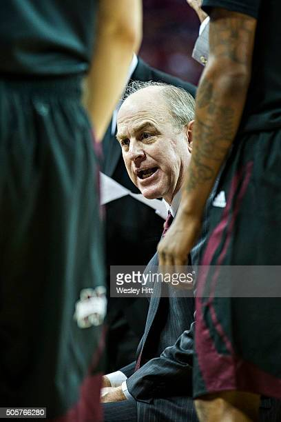 Head Coach Ben Howland of the Mississippi State Bulldogs talks with his team during a timeout during a game against the Arkansas Razorbacks at Bud...