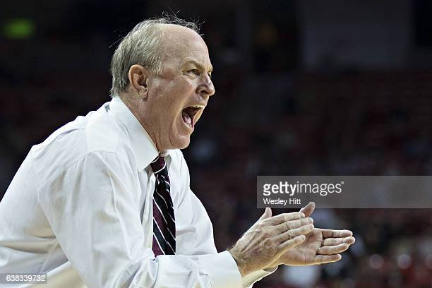 Head Coach Ben Howland of the Mississippi State Bulldogs works the bench area during a game against the Arkansas Razorbacks at Bud Walton Arena on...