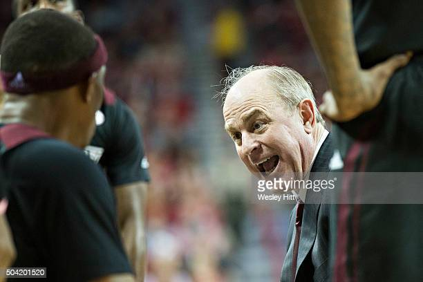 Head Coach Ben Howland of the Mississippi State Bulldogs yells at his players in the huddle during a timeout against the Arkansas Razorbacks at Bud...