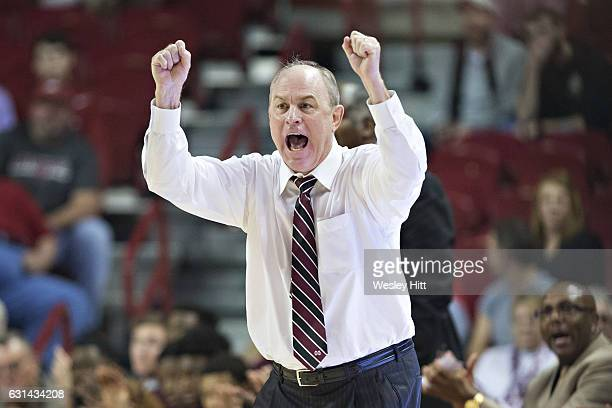 Head Coach Ben Howland of the Mississippi State Bulldogs yells to his team during the first half of a game against the Arkansas Razorbacks at Bud...