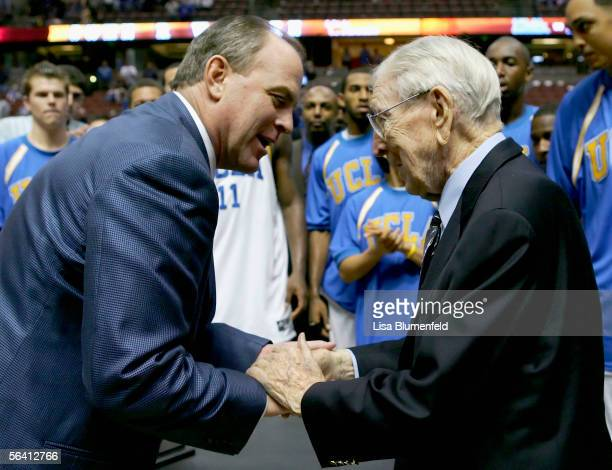 Head coach Ben Howland of the UCLA Bruins greets John Wooden after defeating the Nevada Wolf Pack 6756 during the 12th Annual John R Wooden Classic...