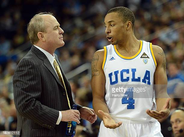 Head coach Ben Howland of the UCLA Bruins speaks to Norman Powell along the sidelines during a 7974 UCLA win at Pauley Pavilion on February 27 2013...