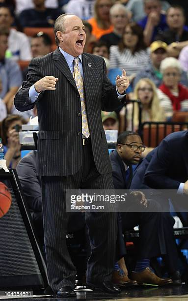 Head coach Ben Howland of the UCLA Bruins watches his team play the Minnesota Golden Gophers during the second round of the 2013 NCAA Men's...
