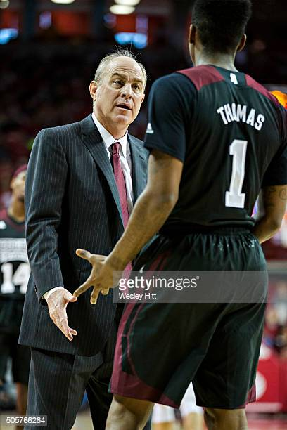 Head Coach Ben Howland talks with Fred Thomas of the Mississippi State Bulldogs during a game against the Arkansas Razorbacks at Bud Walton Arena on...