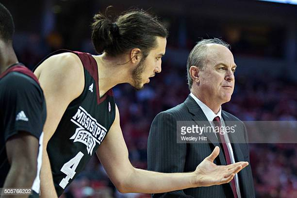 Head Coach Ben Howland talks with Johnny Zuppardo of the Mississippi State Bulldogs during a game against the Arkansas Razorbacks at Bud Walton Arena...