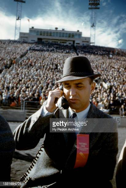 Head coach Ben Martin of the Air Force Falcons talks on the phone on the sidelines during an NCAA game against the Denver Pioneers on November 8,...