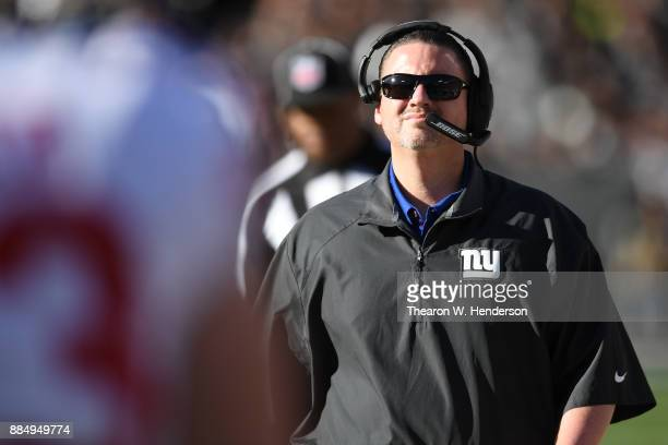 Head coach Ben McAdoo of the New York Giants looks during their NFL game against the Oakland Raiders at OaklandAlameda County Coliseum on December 3...