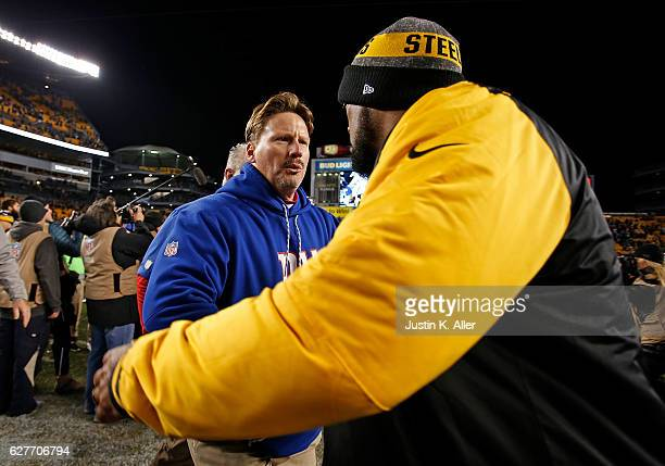Head Coach Ben McAdoo of the New York Giants shakes hands with Head Coach Mike Tomlin of the Pittsburgh Steelers at the conclusion of the Pittsburgh...