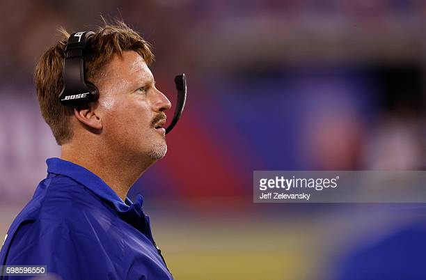 Head coach Ben McAdoo of the New York Giants stands on the sidelines during their preseason game against the New England Patriots at MetLife Stadium...