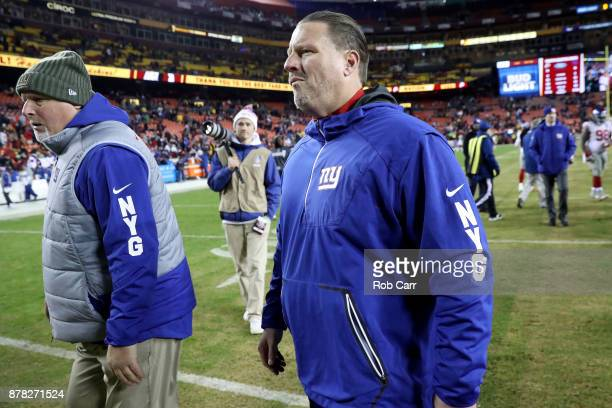 Head coach Ben McAdoo of the New York Giants walks off the field following the Giants 2010 loss to the Washington Redskins at FedExField on November...