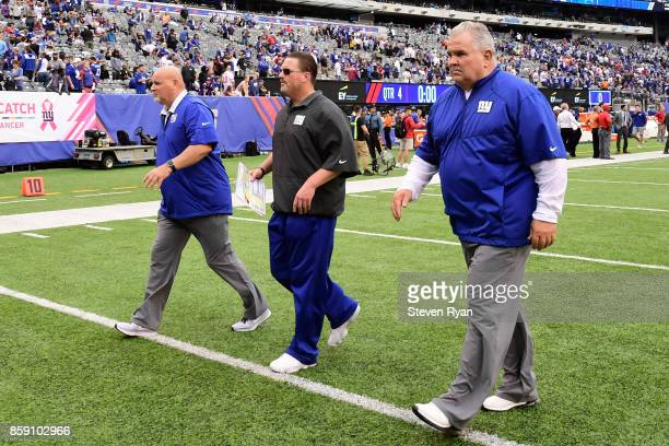 Head coach Ben McAdoo of the New York Giants walks off the field with his staff after losing to the Los Angeles Chargers in an NFL game at MetLife...