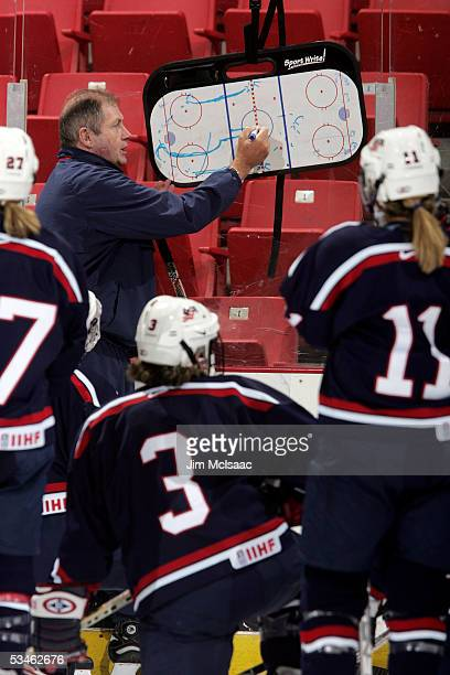 Head coach Ben Smith of the 2006 women's Olympic hockey team diagrams a play during the USA Hockey National Women's Festival on August 25, 2005 at...