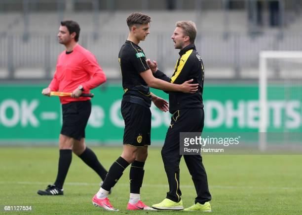 Head coach Benjamin Hoffmann of Dortmund argues with Alexander Laukart of Dortmund during the AJuniors German Championship semi final first leg match...