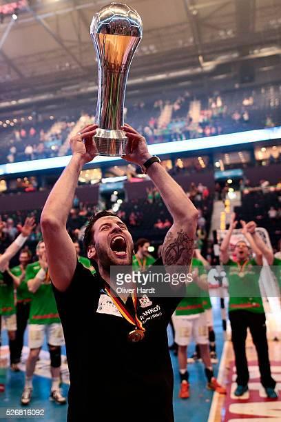 Head coach Bennet Wiegert of Magdeburg celebrate with the trophy after winning the DKB REWE Final Four Finale 2016 between SG Flensburg Handewitt and...