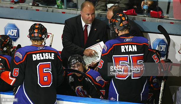 Head coach Benoit Groulx gives some instructions to his Gatineau Olympiques during a stoppage in play against the Belleville Bulls in the 4th game of...