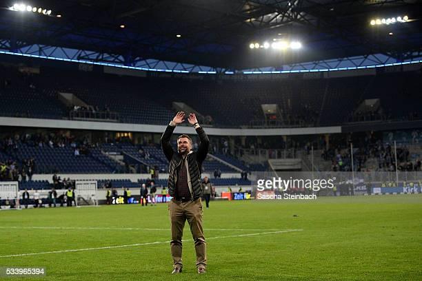 Head coach Bernd Hollerbach of Wuerzburg celebrates after winning the 2. Bundesliga playoff leg 2 match against MSV Duisburg at...