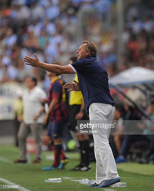 Head coach Bernd Schuster of Malaga FC reacts during the La Liga match between Malaga CF and FC Barcelona at La Rosaleda Stadium on August 25 2013 in...