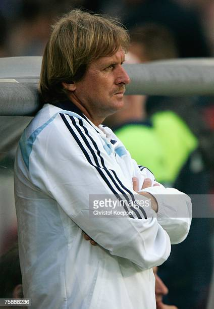Head coach Bernd Schuster of Real looks thoughtful during the friendly match between Hanover 96 and Real Madrid at the AWD Arena on July 31, 2007 in...
