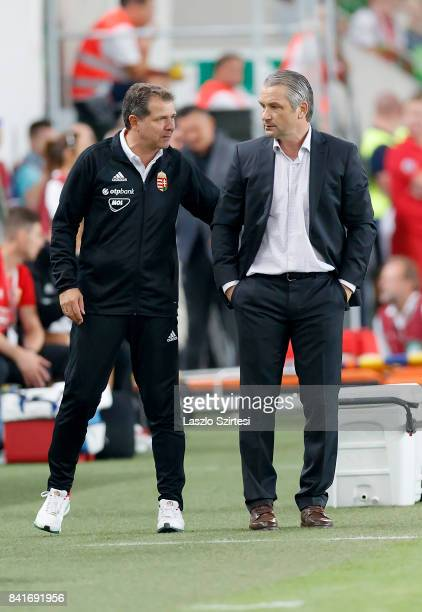 Head coach Bernd Storck of Hungary talks to assistant coach Andreas Moller of Hungary during the FIFA 2018 World Cup Qualifier match between Hungary...
