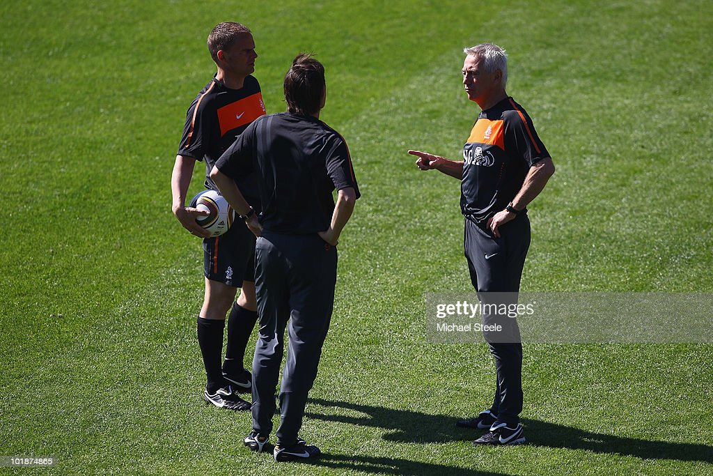 Head coach Bert van Marwijk (r) in discussioin with assistant coaches Frank de Boer (l) and Phillip Cocu (c) during a Netherlands training session at the Wits Rugby Stadium on June 8, 2010 in Johannesburg, South Africa.