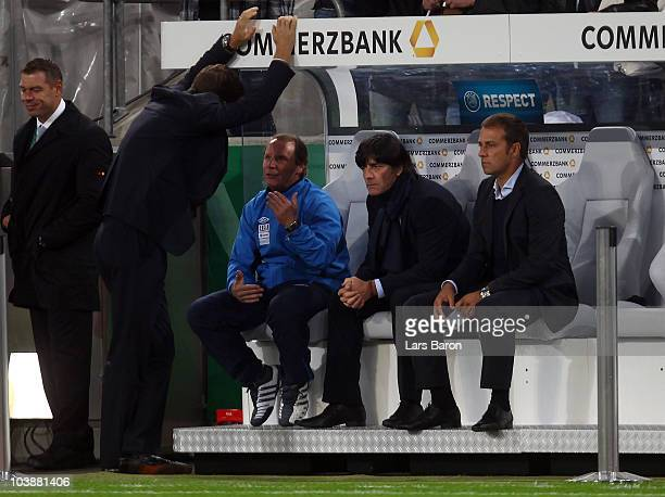 Head coach Berti Vogts of Azerbaijan is seen with head coach Joachim Loew and assistant coach Hansi Flick of Germany during the EURO 2012 Group A...