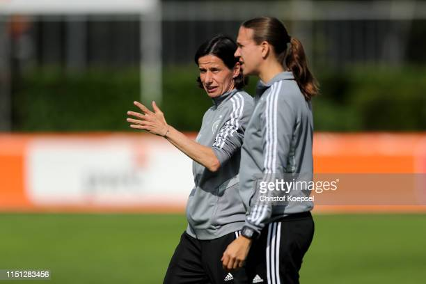 Head coach Bettina Wiegmann and athletic coach Claudia Wehrsen of Germany talk prior to the International Friendly match between U15 Girl's...