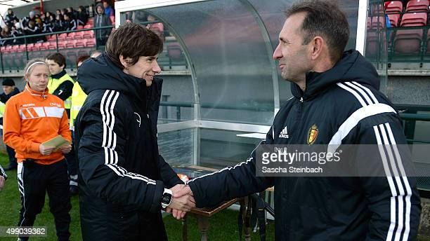 Head coach Bettina Wiegmann of Germany and head coach Luc Bosmans of Belgium shake hands prior to the U15 girl's international friendly match between...