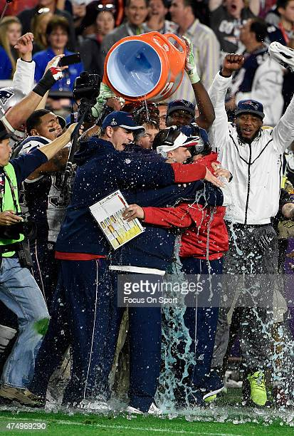 Head coach Bill Belichick and coaches of the New England Patriots celebrates after they defeated the Seattle Seahawks in Super Bowl XLIX February 1...