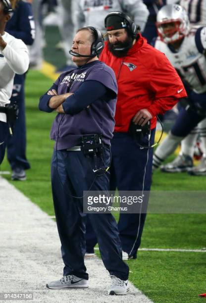 Head coach Bill Belichick and defensive coordinator Matt Patricia of the New England Patriots looks on from the sidelines during the fourth quarter...