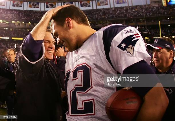 Head coach Bill Belichick and quarterback Tom Brady of the New England Patriots meet after the game against the San Diego Chargers after the AFC...